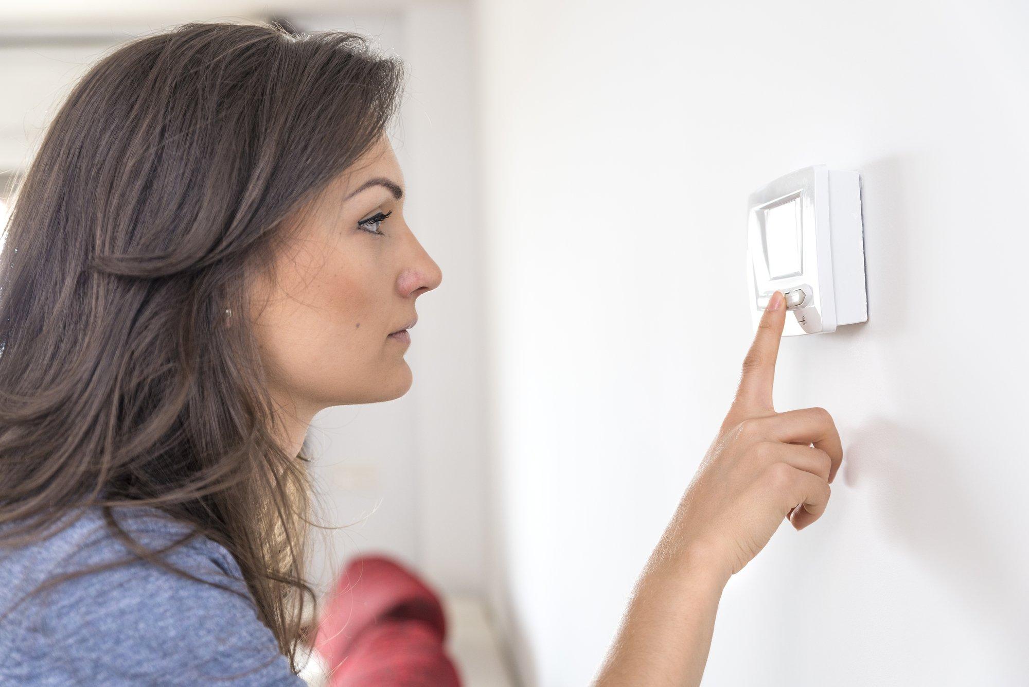 adjusting air conditioner temperature