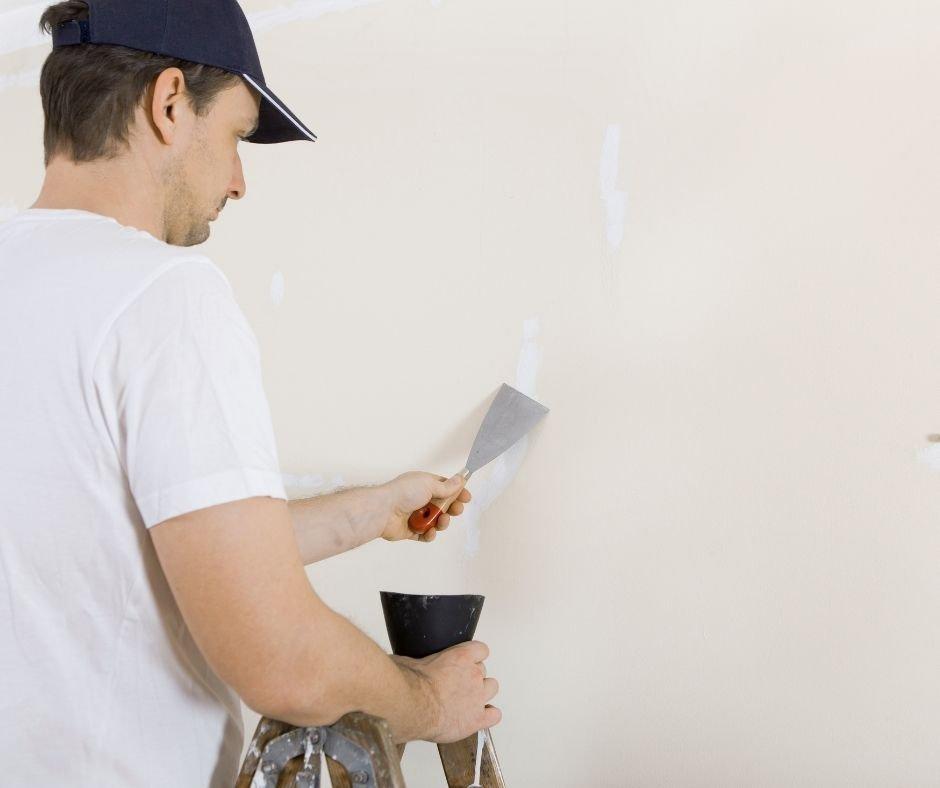 winter home maintenance mending a wall
