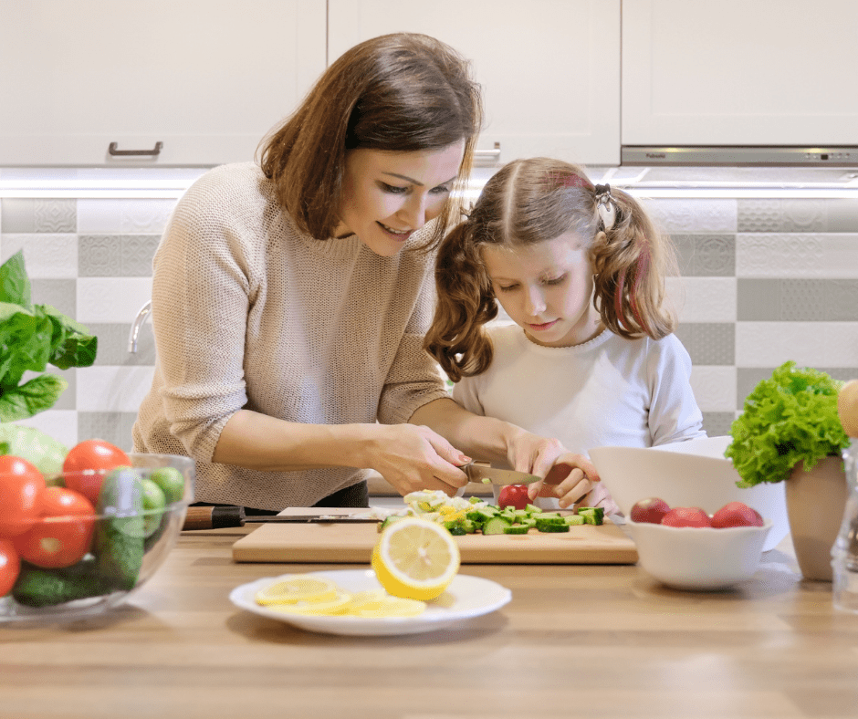 Girl learning to cook with her mom