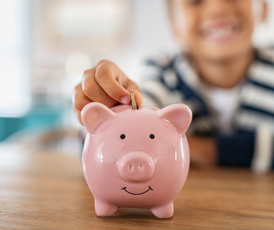 Boy saving money in his piggy bank