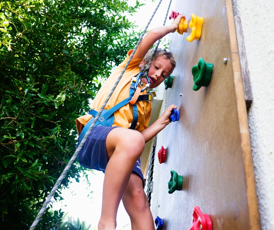 Child learning resilience wall climbing